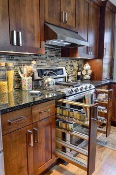 Kitchen--good idea for small spaces where nothing else will fit. Different heights of spice containers along the side of the stove
