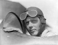"""Charles Lindbergh, wearing helmet with goggles up, in open cockpit of airplane at Lambert Field, St. Louis, Missouri"" by Scott Kraft"