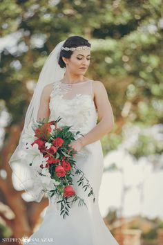 The bride looks so elegant, with her sparkly headpiece and veil, and cascading bouquet of red roses and white lilies! | Wedgewood Pacific View Tower // Stephen Salazar Photography