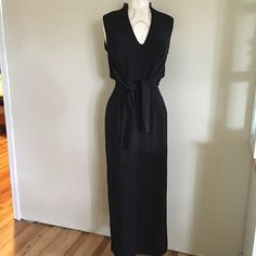 Giorgio Armani dress Very classic style dress! It has a cape(?) thing on the back that has snaps and ties(?) the cover picture I have them tied in the front I am not sure how it is to be styled but it is in great condition! No holes rips or stains Giorgio Armani Dresses