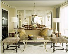 Lovely living/dining combination. The mirrors are good for visually increasing the size of the room.