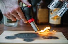 Jockey Hollow Bar & Kitchen, Morristown, NJ Ingredients 1 cedar plank 2 oz. Bulleit rye 1 bar spoon 2:1 Demerara syrup 3 dashes Angostura bitters 2 dashes orange bitters Directions Using a crème brûlée torch, blaze a cedar plank and cap the smoking spot with an old fashioned glass, infusing the glassware. In a separate mixing glass, stir the rye, syrup and both bitters with ice. Turn over the seasoned glass and strain the cocktail over a large ice cube. Garnish with a twist of orange.
