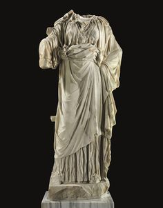 A ROMAN MARBLE FIGURE OF A WOMAN CIRCA 1ST-2ND CENTURY A.D.