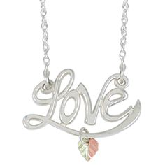 """Love Pendant Necklace, Sterling Silver, 12k Green and Rose Gold Black Hills Gold Motif, 18"""". The Word Love Adorned with Hand Placed Floating Two-Tone Heart Shaped Grape Leaf; Represents Token of Love; Pendant is Crafted in Polished Sterling Silver; Suspended from a Hypoallergenic Rhodium Plated Sterling Silver Rope Chain. Hand-Engraved, Hand-Placed, Diamond-Cut, Satin Finished 12k Green and Rose Gold Heart. Pendant Measures .74 Inches High by .895 Inches Wide; Suspended from a Rope Chain..."""