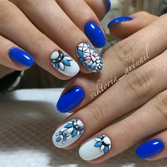 Tribal Blue Nail Art Design. Tribal blue nail art design is one of our best nail art design. The use of different shades of blue color and white tones in the tribal pattern can make you go wow.