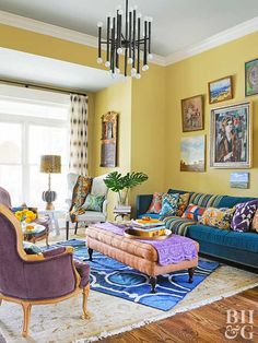 Yellow is one of many colors featured in this eclectic living room. The yellow walls host a gallery of colorful art, and a pacific blue sofa holds plenty of patterned pillows. Layered rugs soften the Yellow Living Room Accessories, Yellow Walls Living Room, Living Room Paint, Living Room Colors, Living Room Sofa, Yellow Rooms, White Rooms, White Walls, Light Yellow Walls