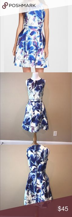 Vince Camuto fit and flare blue floral dress sz 10 Beautiful blue floral hibiscus print dress Vince Camuto dress in size 10. Fit and flare with tailored and darted bust and A line skirt. Crew neckline with banded waist and piping. Sleeveless. Exposed back zip. 97%cotton 3%spandex. Bust 18 inches waist 15 inches hips 27 inches. NWOT. No trades but offers are welcome. Vince Camuto Dresses