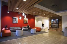 Drop ceiling or wrap around cubes on main floor? Or a wall treatment elsewhere? | Office Design Gallery via Pioneer Millworks