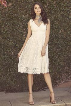 Lulus Exclusive! You're sure to make a lovely first impression in the Charmed Ivory Lace Midi Dress! Floral lace dress has a V neck and back, darted accents, and a banded waist. Flaring skirt reaches an elegant midi length. Hidden back zipper.