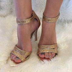 ⚡️flash sale⚡️NWOT Heart in D gold sandal heels These shoes are brand new, never wore! In excellent condition! 4 1/2 inch heels. Side buckle. Man made materials. Rubber soles. Padded sole for comfort. Smoke free pet free home. Heart in D Shoes Heels