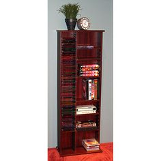 CD/DVD Tower Storage Unit, Cherry  You can use this to store punches.  Create some boards the size of a CD and use it as a shelf for your punches.  You can accommodate many sized punches.  The other side can be used for unmounted stamp storage in DVD boxes.