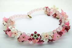 https://vintagelanejewelry.com/products/pink-pearly-white-and-dark-pink-lucite-flowers-and-pale-pink-glass-beaded-necklace