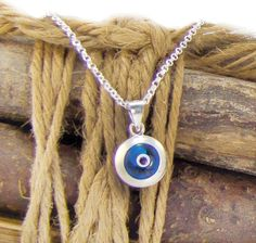 Beautiful Sterling Silver Necklace consisted of a Blue Evil Evil Eye Silver & Glass Pendant which hangs on a all time classic Silver Chain.