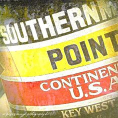 Key West ... the Southernmost point in the continental US... 90 Miles to Cuba. My daughters have both touched this marker. Though they probably dont remember that. Summer, 1994