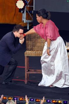 Bono kisses Oprah Winfrey's hand during the second taping of the 'Oprah Winfrey Show' at the Sydney Opera House on December 14, 2010 in Sydney, Australia. ©SIPA #u2newsactualite #u2newsactualitepinterest #bono #theedge #larrymullen #adamclayton #u2 #music #rock