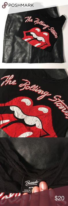 The Rolling Stones Graphic Tee The Rolling Stones Graphic Tee. Feel edgy and fun in this class band tee. Size M and is 100% rayon. Great with a leather mini skirt and heels! Bravado Tops Tees - Short Sleeve