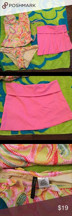 Tankini with skirt coverup Paisley print tankini top and bottom, with ruffle trim. Pink skirt cover up. All three pieces are BCBG. Top is halter with drawstring on side, size medium, skirt is medium and bottoms are *large*. BCBG Swim Bikinis