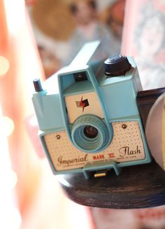 A baby blue Imperial Mark XII vintage camera!  http://www.sfgirlbybay.com/2011/03/03/vintage-finds-for-a-modern-world-smile-for-the-camera/