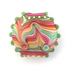 Bead by michals.http://www.etsy.com/listing/72289357/olive-and-pink-lampwork-lentil-focal