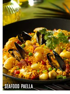 Enjoy a #Caribbean classic, our #Seafood #Paella is served with sauteed scallops, shrimp, fish, mussels, chicken and sausage with yellow rice. Click to view recipe.