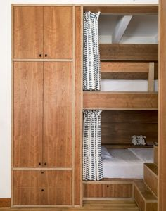 Kids' bedroom with custom built-in bunkbeds in cherry plywood with curtains | Workstead design, Matthew Williams Photo