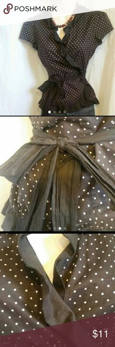 Dark Brown Polka-dots and Ruffles Wrap-around Top Romantic top! Slightly sheer cotton fabric.  Beautiful ruffling details. Wrap-around top.  Chocolate brown with small white polka dots. Includes a lycra shelf bra camisole in same brown.  New York and Company.  Size S New York & Company Tops Blouses