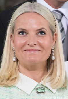 Crown Princess Mette-Marit, one of his godmothers, wore pearls and diamonds, plus her lovely aquamarine and diamond brooch. May 2016