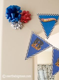 My baby turned 4!!! I can not believe it! He told me he wanted his party to be a Hot Wheels party – his favorite! It was just a small family party this year but I made a bunting for him to decorate. I felt like the sides needed something so I just threw some bows …