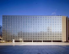 """Institute du Monde Arabe by Jean Nouvel: The facade of this Paris museum sleekly contemporary while respecting an Arabic heritage, is composed of 250 panels with metal """"eyes"""" which dilate and constrict in response to ambient light and in turn controlling both interior lighting and thermal exposure via the 30,000 apertures."""