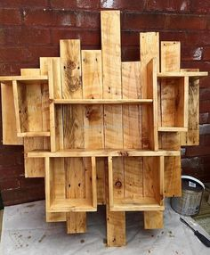 This reused pallet wood shelf art is another very creative art, it gives your place a simple, classic and rustic look. The different sized and styled shelves and open cabins not only serve the decor purpose but also giving you a variety of functions. Place your goods and decoration pieces with ease.