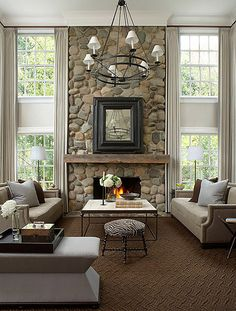 love the idea of two sofas | zebra stool | love the way the curtains are hung | rock fireplace | Stephen Knollenberg