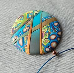 handmade polymer clay pendant by dumauvobleu on Etsy