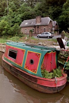 Derelict mini narrowboat near Macclesfield