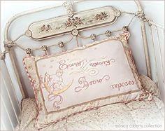antique French crib (lit de bébé) and embroidered pillow