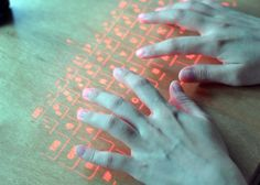 The Atongm Laser Keyboard projects a virtual laser keyboard on to a flat surface, supposedly letting you type like you normally would.