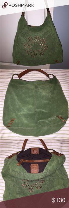 NEW REDUCTIONLucky Brand shoulder bag NEWREDUCTIONBeautiful green bohemian Lucky Brand handbag. Material: green color suede and brown leather detailing and handle. Used a couple maybe 3 times. Shows some signs of normal and careful use: almost unnoticeable small dark area from rubbing against clothes in the back corner (shown on pic #2) and a small scratch on handle. This purse features a zippered pocket inside and a magnetic closure. Please ask if need additional pictures. Thanks for…