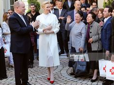 Princess Charlene (C) and Prince's Albert II (L) of Monaco leave after a family picture with refugees after giving them parcels at Red Cross headquarters' during the annual charity ceremony on November 17, 2016.Prince Albert II and Princess Charlene will attend several events before the Monaco National Day on November 19, in Monaco.  / AFP / POOL / VALERY HACHE        (Photo credit should read VALERY HACHE/AFP/Getty Images)