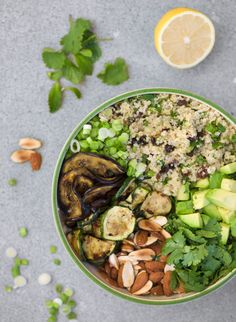 Beautiful buddha bowl... Quinoa, scallion, eggplant, zucchini, avocado, cilantro, lemon and chopped almonds. #glutenfree #vegan.