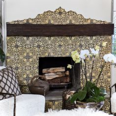 AMERICAN DREAM BUILDERS - SPANISH MEDITERRANEAN STYLE - AFTER - Living Room Fireplace, we decided to use this stunning hand made Spanish tile as the fireplace mantle - makes the room. www.LukasMachnik.com #DreamBuilders #AmericanDreamBuilders #TeamRED #Spanish #NBC