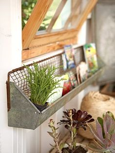 Chicken feeder as a shelf.  Very cute idea for a potting shed, or even a spice rack