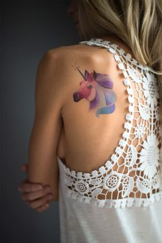 Unicorn temporary watercolor style tattoo by Sasha Unisex. https://www.tattooyou.com/product/sasha-unisex-unicorn/