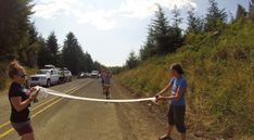 Arielle and Casey cresting a 5K hill on her last leg (he was running support) and breaking a toilet paper tape held by Melissa and Jenny #NuunHTC #HTC14 #GoPro