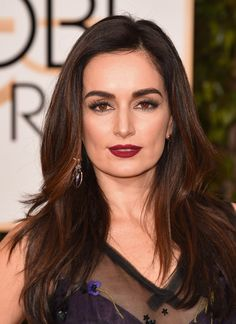 Ana De La Reguera charmed with her sultry black eyeliner and deep scarlet lips. The brunette beauty's brows topped off her bold look.