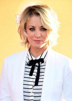 Kaley Cuoco looked cute and gorgeous in a white pantsuit while posing for the photographers on the red carpet of the All-Star Dog Rescue Celebration held at The Barker Hangar in Santa Monica, California. The event organized by charitable organization was held on November 21, 2015....