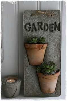 Concrete & Terracotta ~ No instructions, but just looking at the photo you can figure it out... make a garden sign out of Hypertufa <3