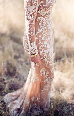 Nude, long-sleeved gown with white details