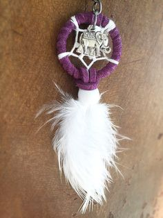 This elephant dream catcher keychain is perfect to hang on your purse, keys, or even in your car! Makes for a great gift.