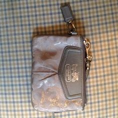 ⬇️REDUCED⬇️Silver Coach wristlet Silver Coach wristlet in great condition. Coach Bags Clutches & Wristlets