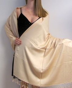 An evening wrap is just the perfect touch to complete your evening wear look.  http://www.yourselegantly.com/catalogsearch/result/?q=evening+wrap&order=relevance&dir=desc