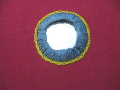 Step 3: Now we will start working the shisha stitch. This version is similar to a buttonhole stitch but with a little variation.  (a) Bring...